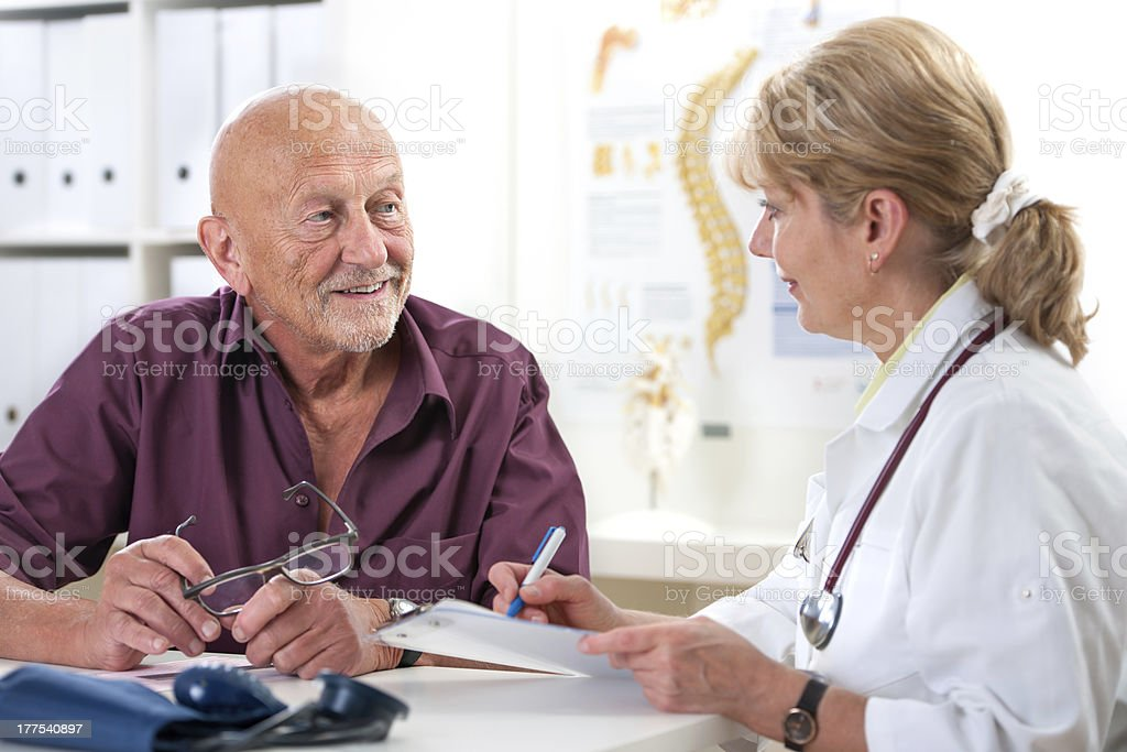 Female doctor discussing a male patients medical exam royalty-free stock photo
