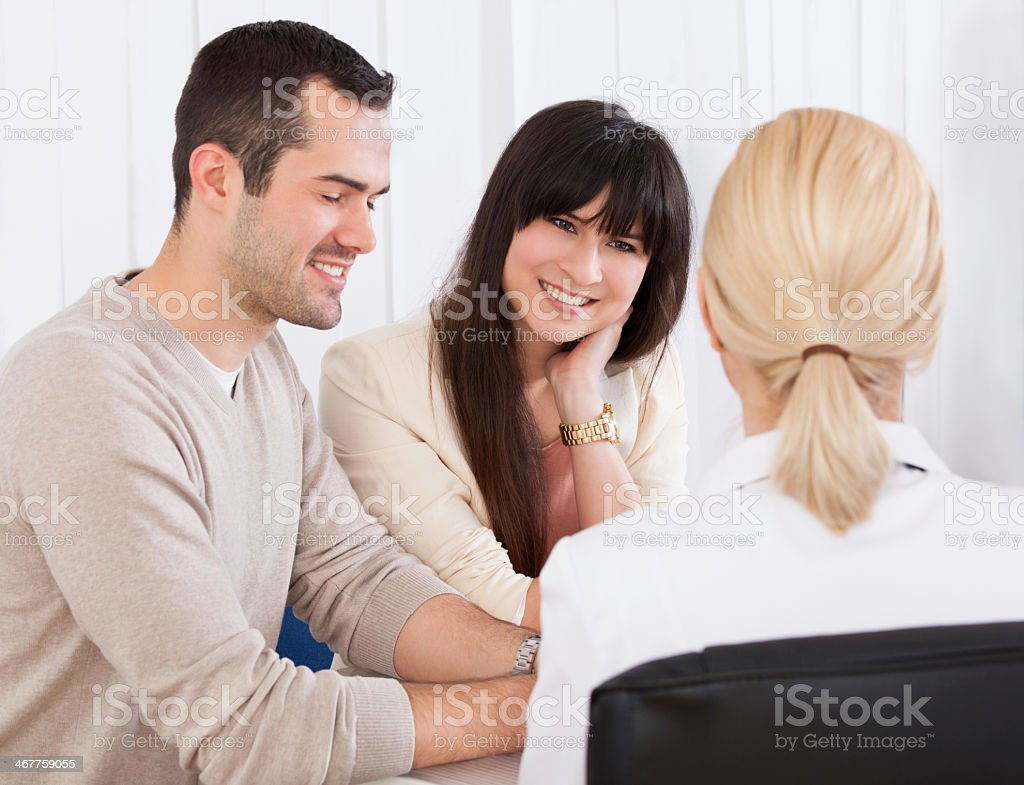 Female doctor discussing with couple royalty-free stock photo