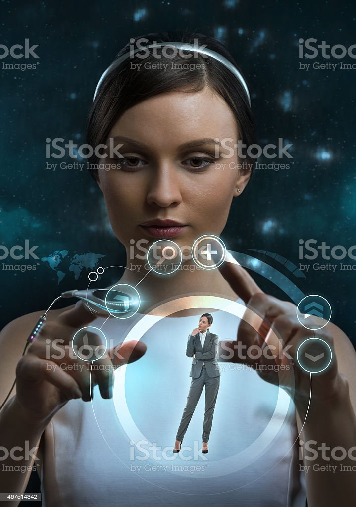 Female doctor doing checkup of human body using futuristic computer stock photo