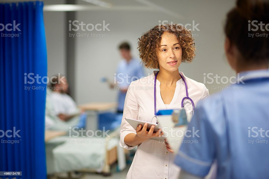 female doctor doing her rounds stock photo