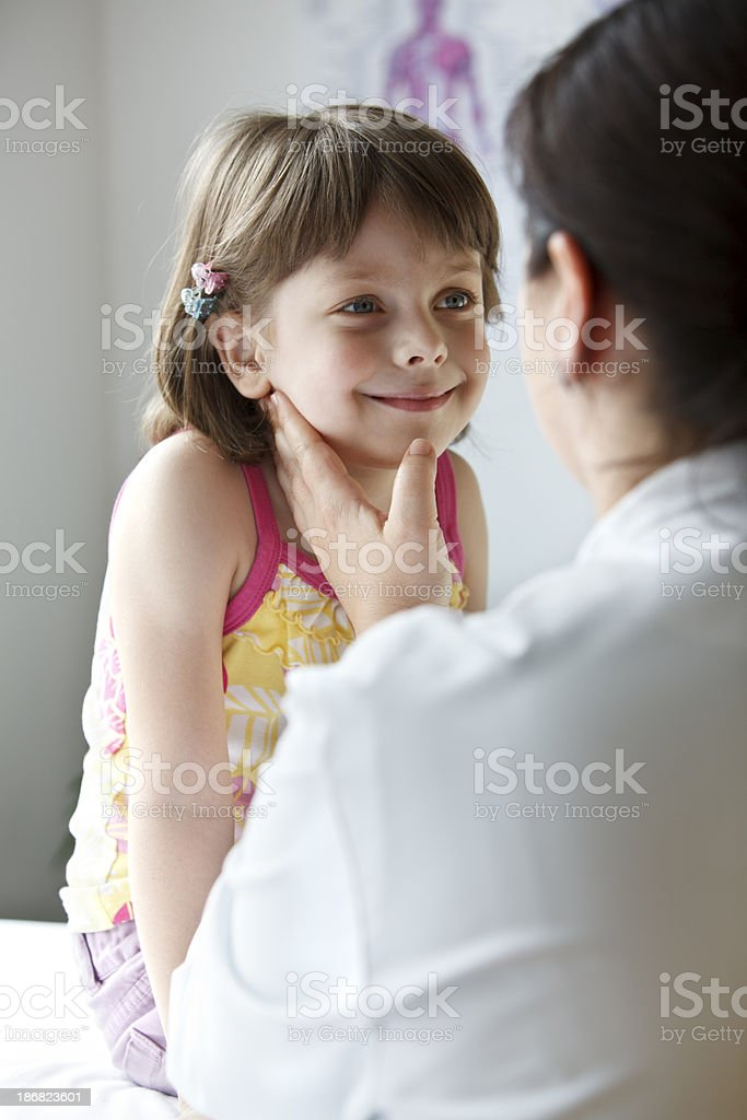 Female doctor examining a little girl royalty-free stock photo