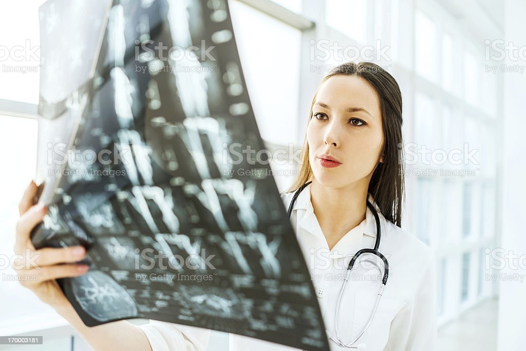 Female doctor examining an x-ray image. royalty-free stock photo