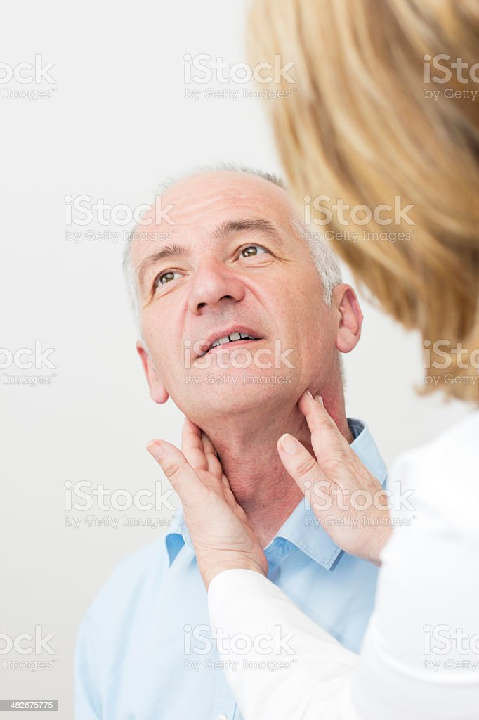 Female doctor examining her  patient stock photo