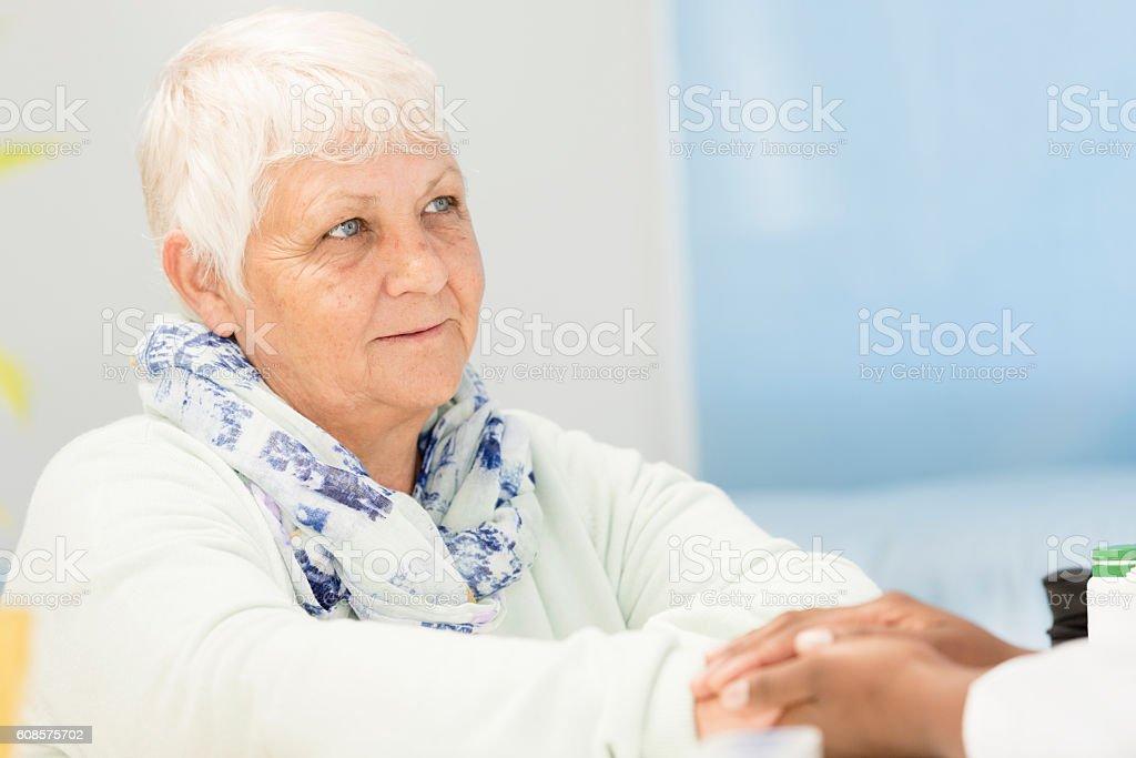 Female Doctor Examining Senior Female Patient stock photo