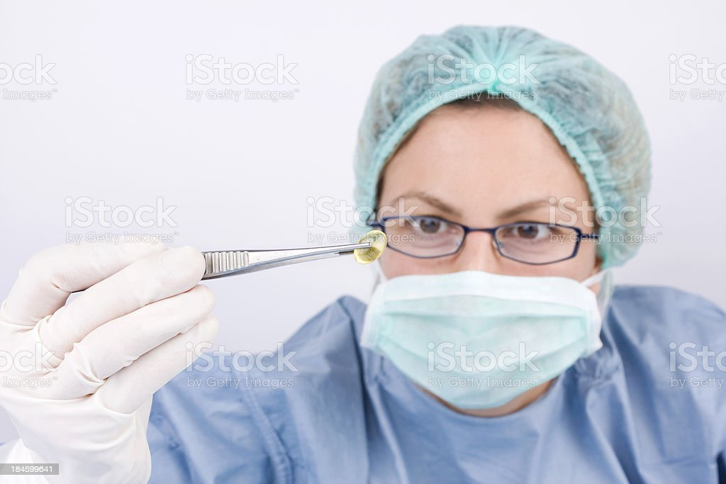 Female doctor examining vitamin pill royalty-free stock photo