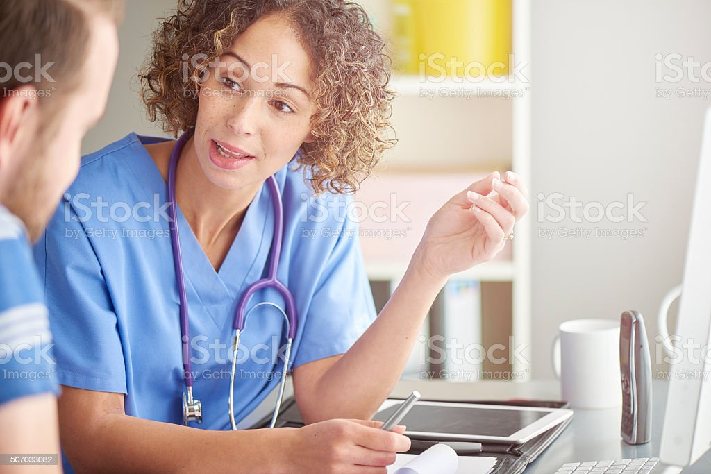 female doctor explaining to patient . stock photo