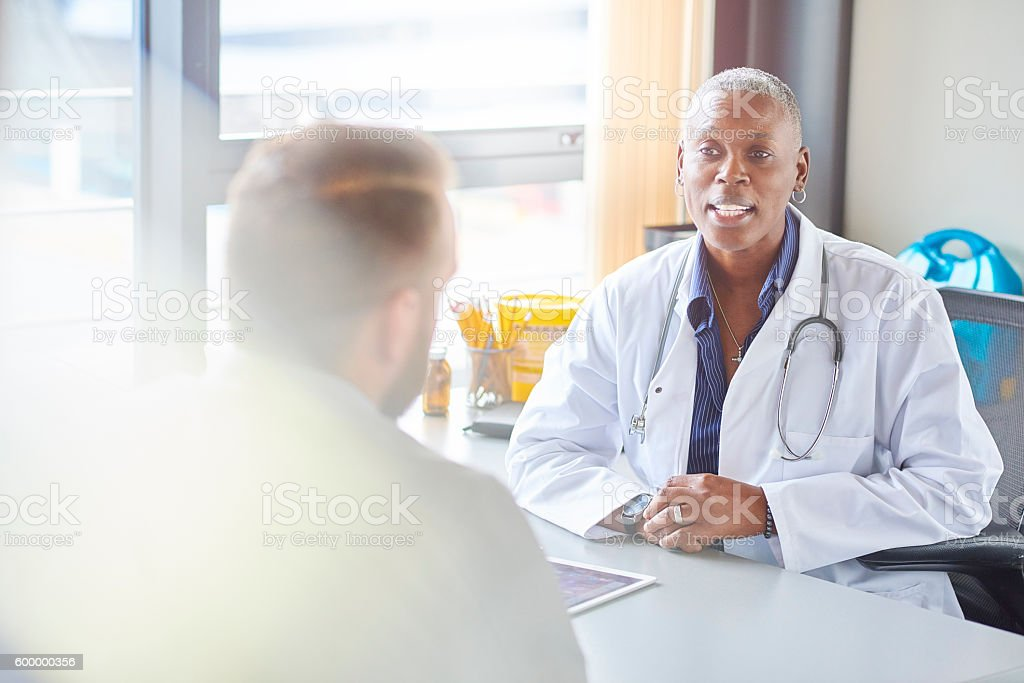 female doctor gives diagnosis stock photo