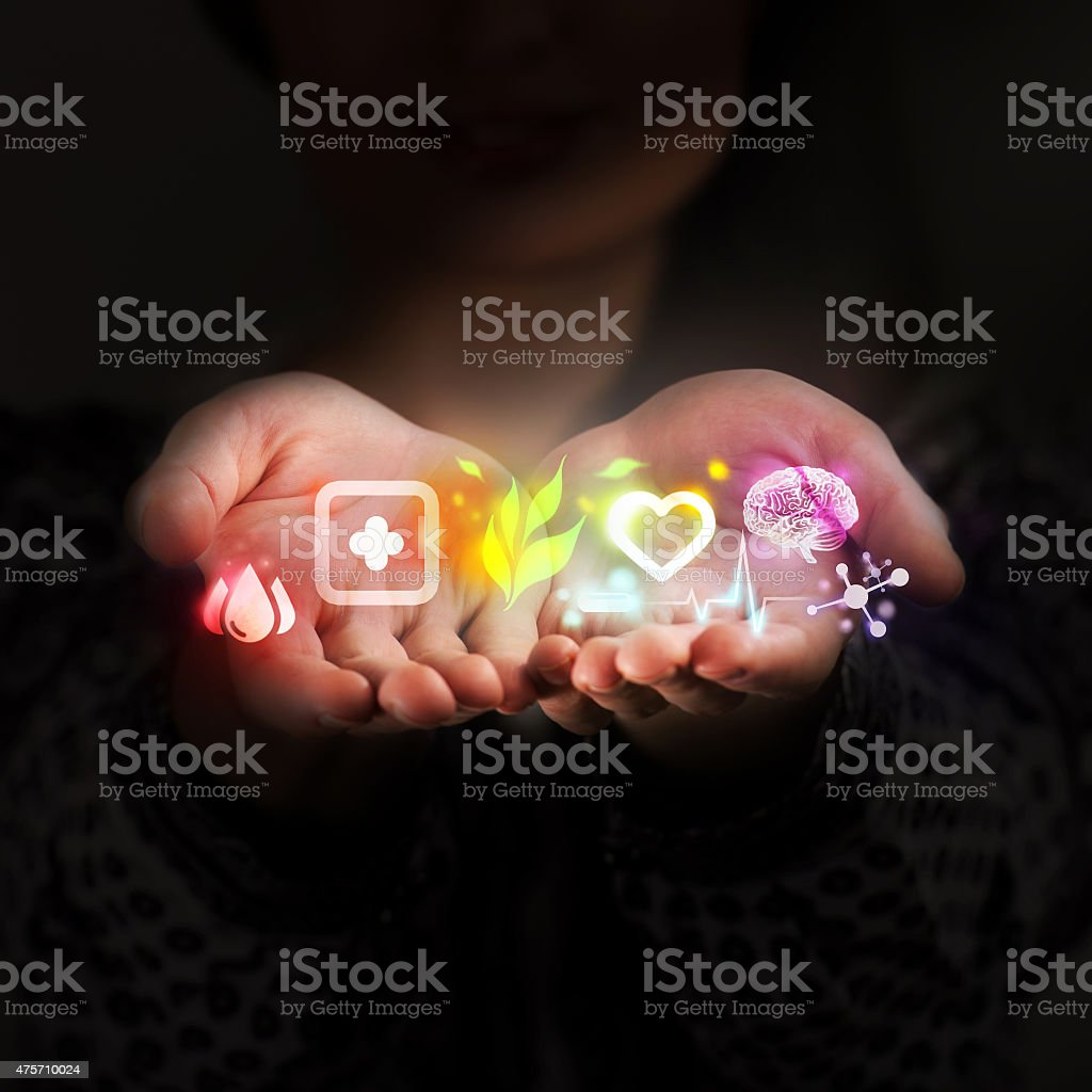 Female doctor hand holds virtual medical icons as medical concept stock photo
