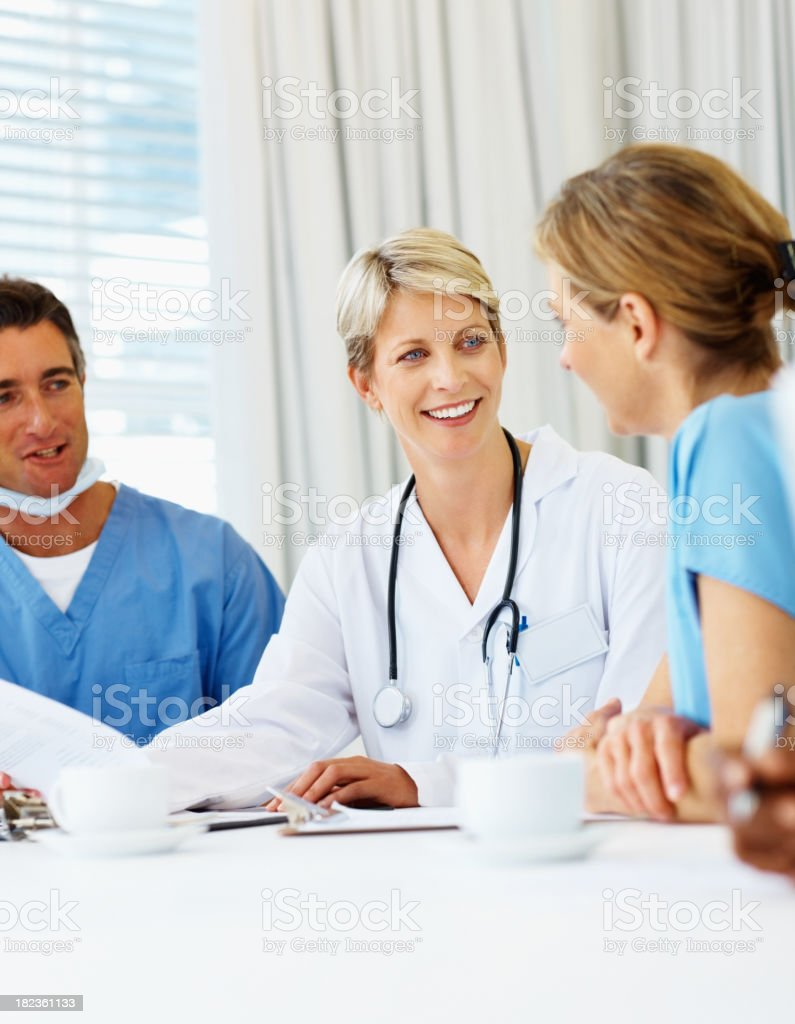 Female doctor having a discussion with colleagues royalty-free stock photo
