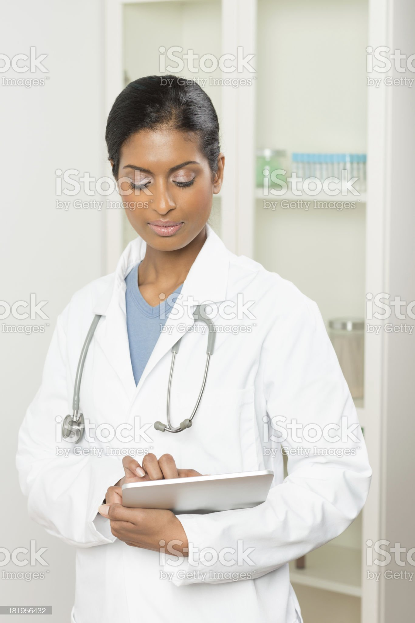 Female Doctor Holding Digital Tablet royalty-free stock photo