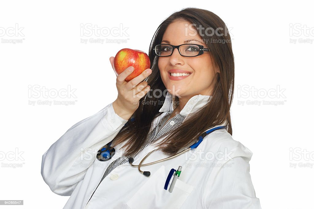 Female doctor holding red apple royalty-free stock photo