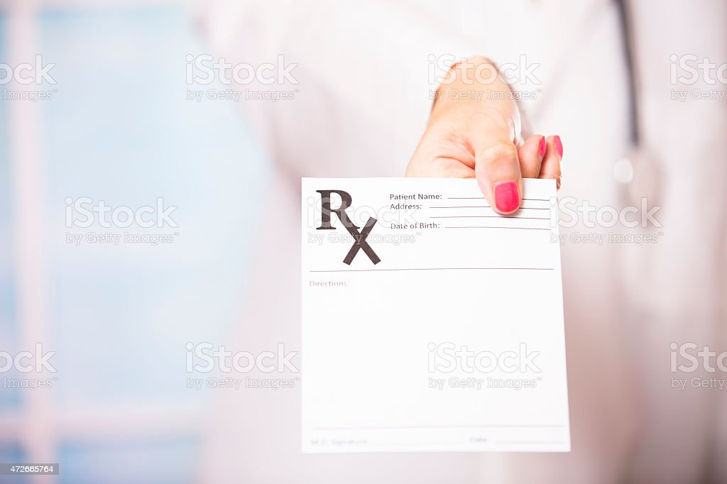 Female doctor holds blank prescription document. Hospital, clinic. stock photo