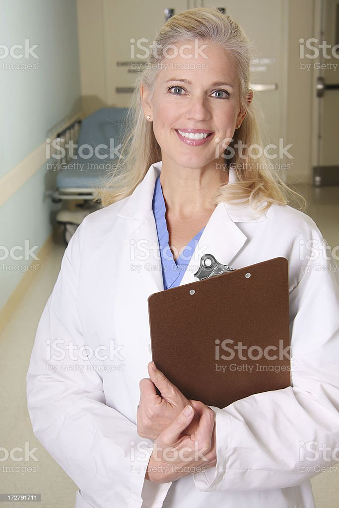 Female Doctor in Hospital Hallway 3 royalty-free stock photo
