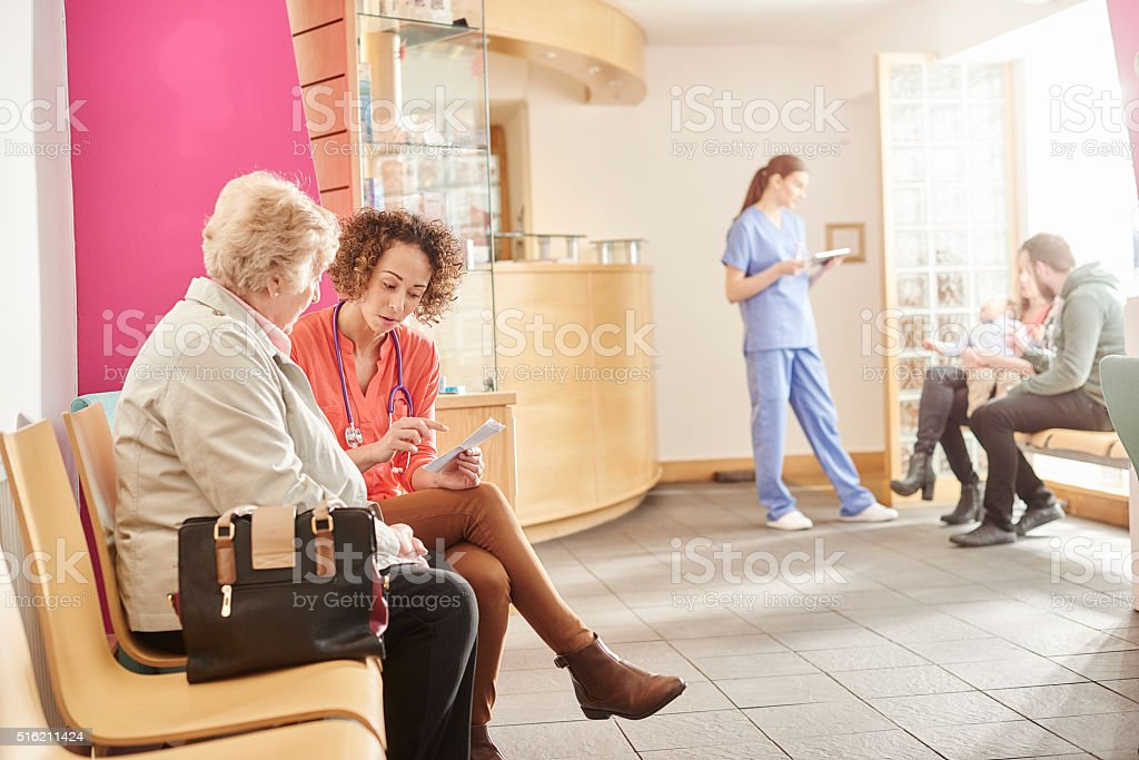 female doctor in the waiting room of her clinic stock photo