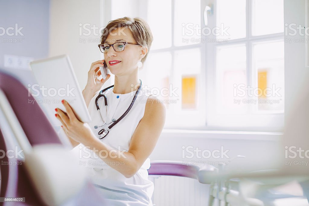 Female doctor is working in the surgery stock photo