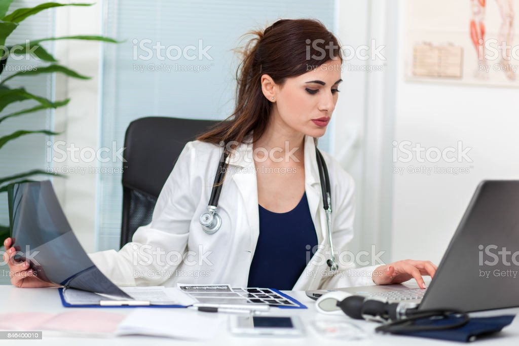 Female doctor looking at an xray stock photo