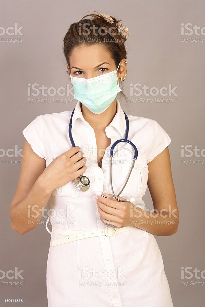 Female doctor looking at camera in a mask royalty-free stock photo