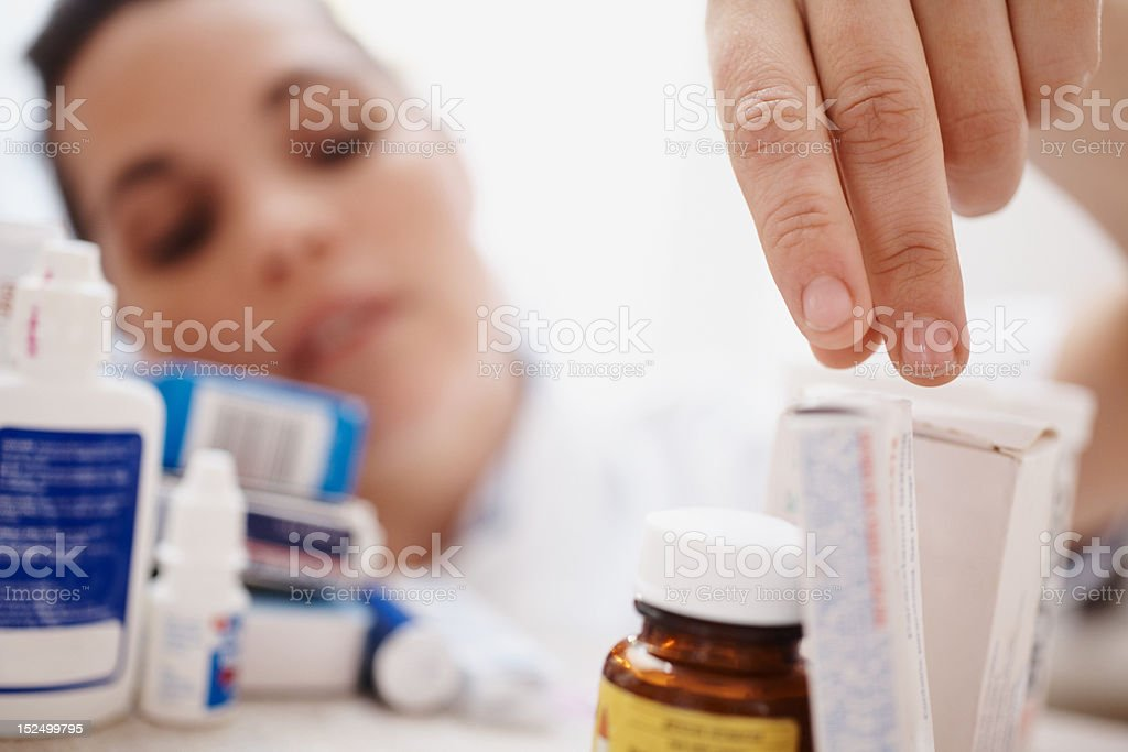 Female doctor picking a medicine royalty-free stock photo
