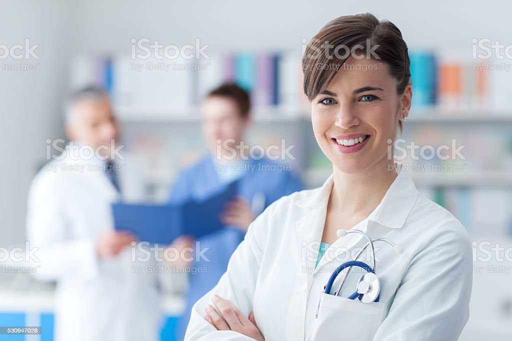 Female doctor posing in the office stock photo