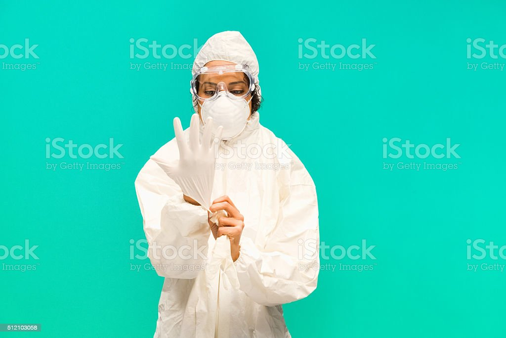 Female doctor putting gloves stock photo