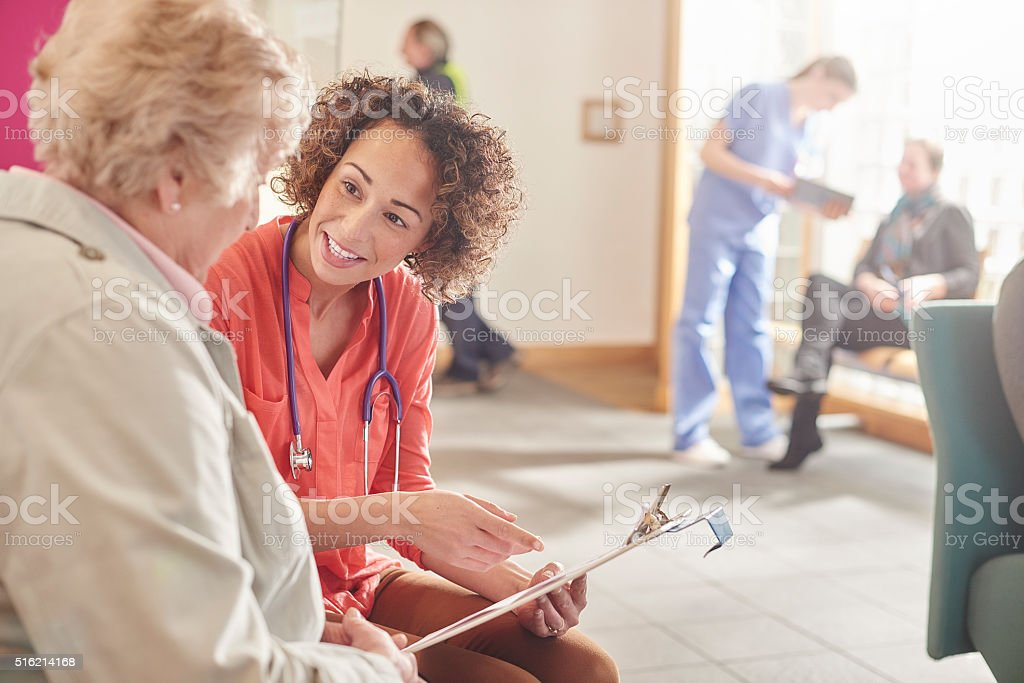 female doctor questionnaire stock photo