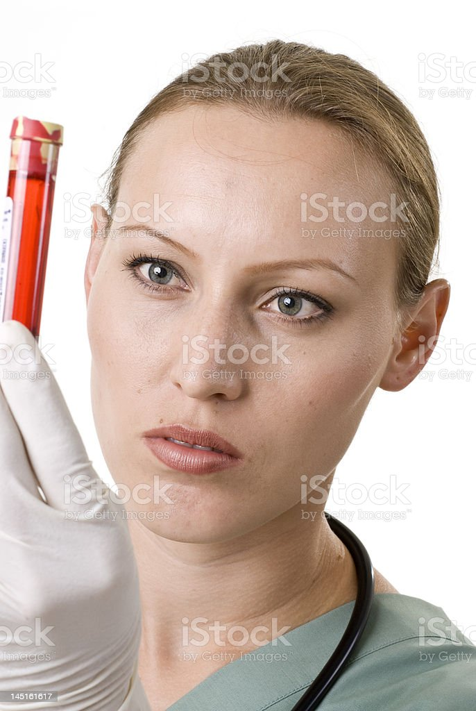 Female Doctor Reviewing a Blood Sample royalty-free stock photo