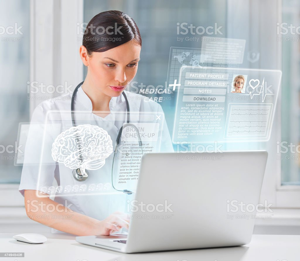 Female doctor scanning brain of patient stock photo