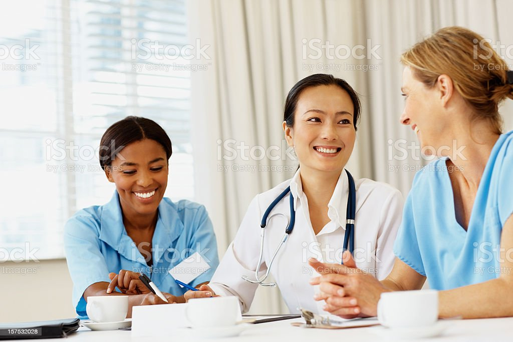 Female doctor smiling during at a meeting royalty-free stock photo