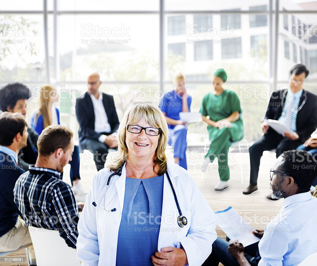 Female Doctor Standing in Front of a Support Group stock photo
