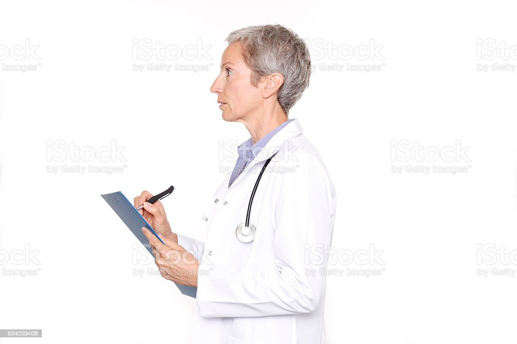 Female Doctor Taking Notes stock photo