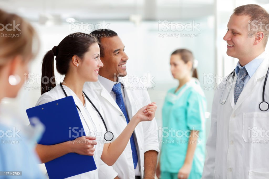 Female doctor talking with hospital team. royalty-free stock photo