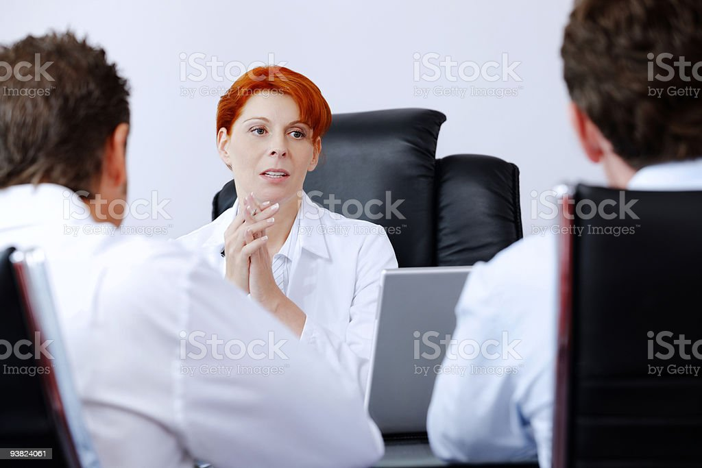 female doctor talking with two male patients royalty-free stock photo