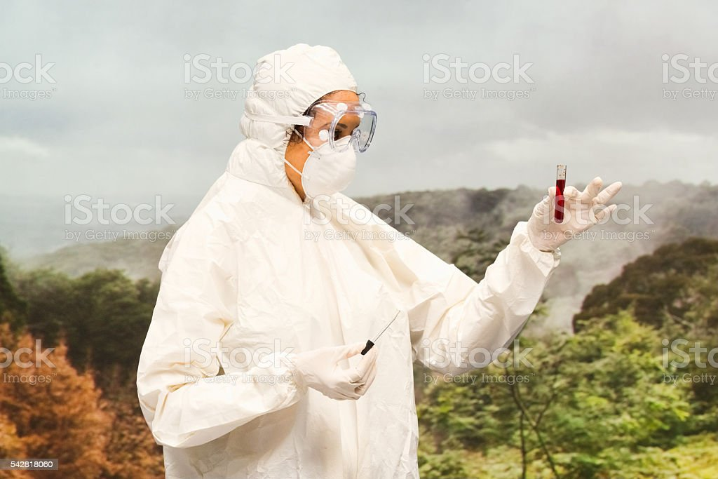Female doctor testing blood with test tube stock photo