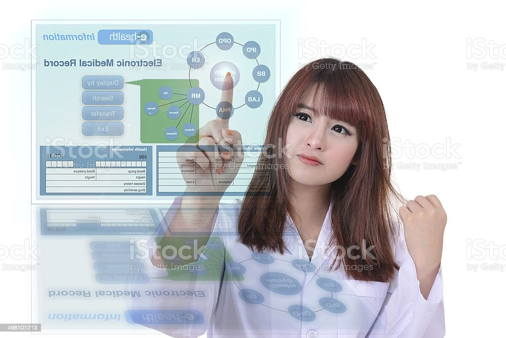 Female doctor uses electronic records system stock photo
