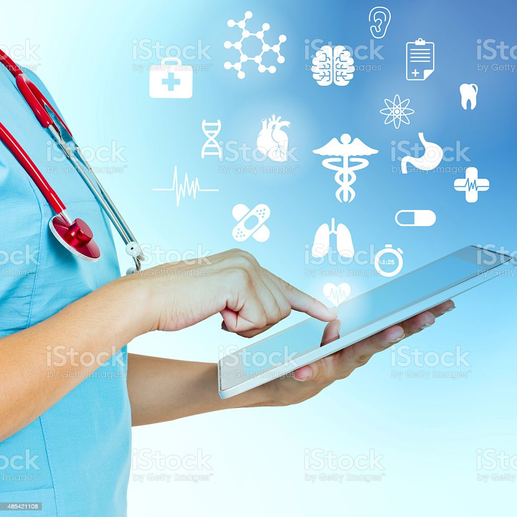 Female doctor using digital tablet stock photo