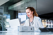 Female doctor using laptop in clinic