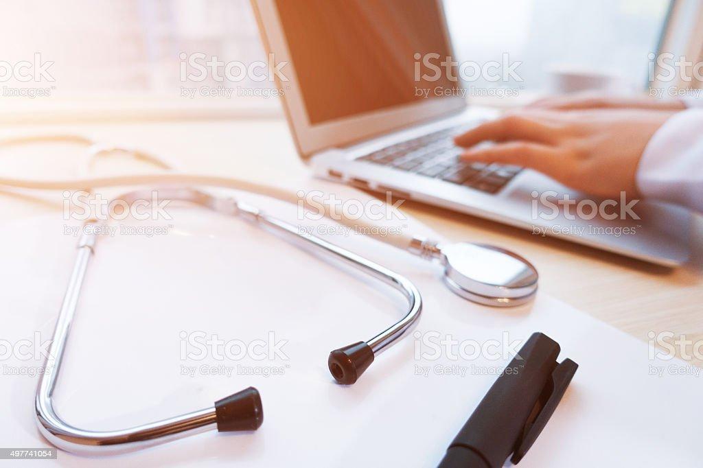 Female doctor using laptop stock photo