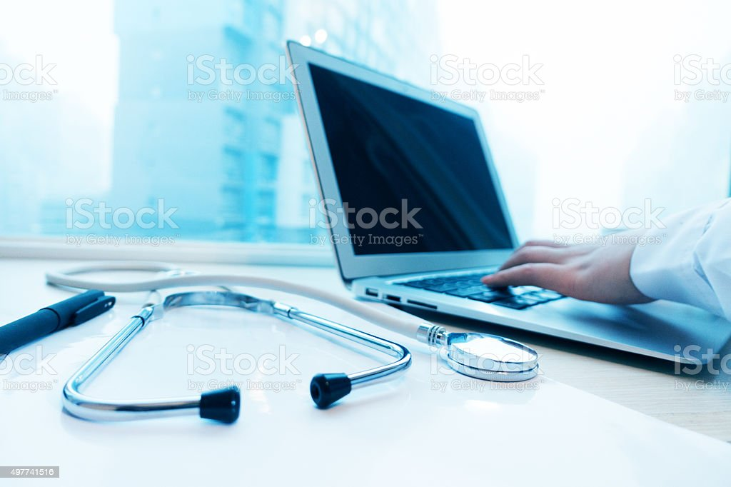 Female doctor using laptop stock photo