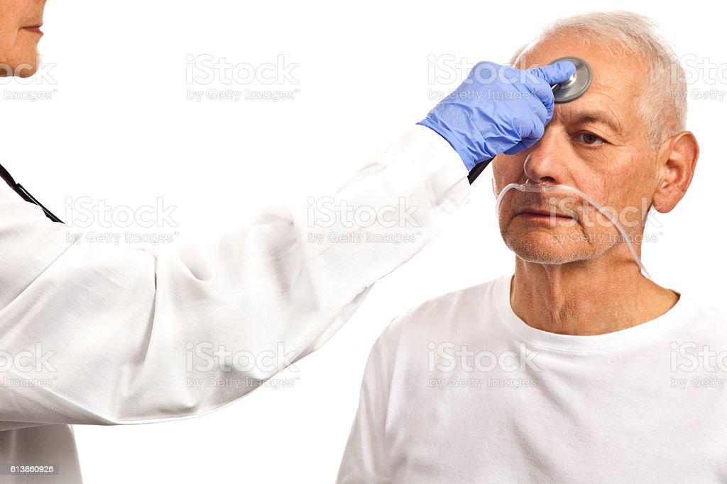 Female Doctor wearing blue latex gloves checking forehead with stethoscope stock photo