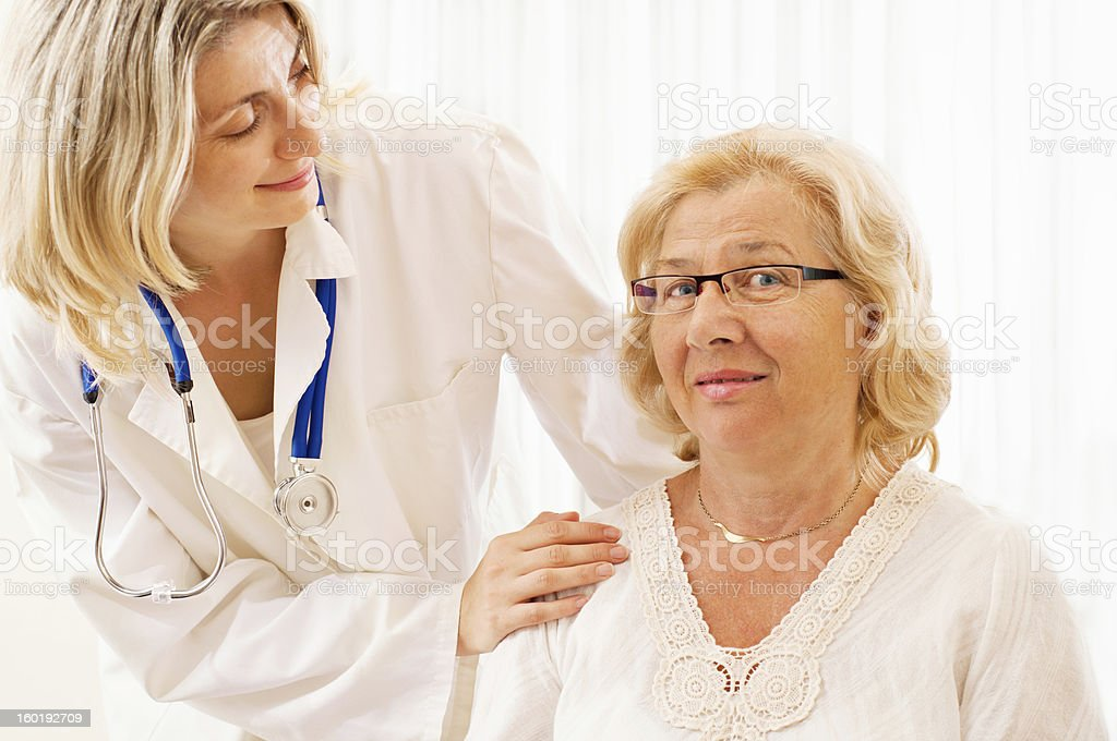 Female doctor with a senior patient royalty-free stock photo