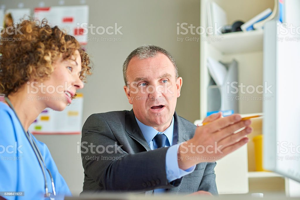 female doctor with administrator stock photo