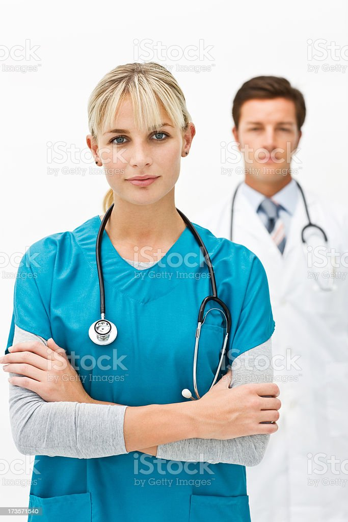 Female doctor with colleague in the background royalty-free stock photo