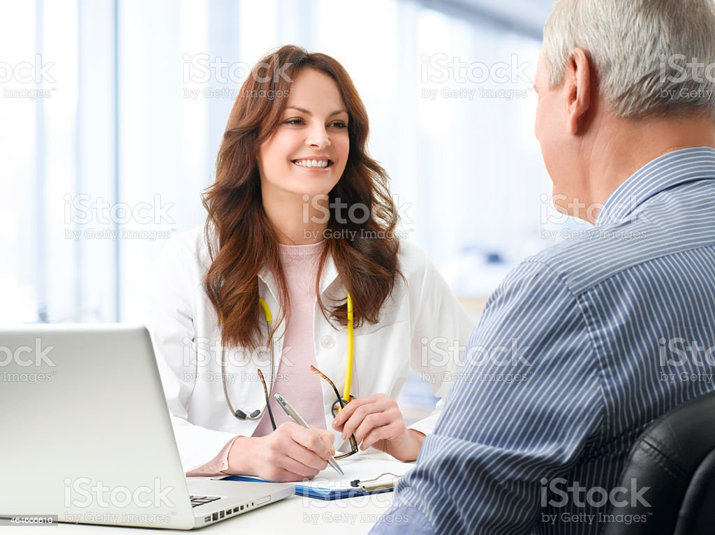 Female doctor with her patient stock photo