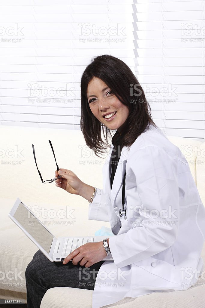 Female doctor with laptop royalty-free stock photo