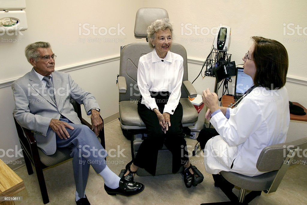 Female Doctor with senior patients royalty-free stock photo