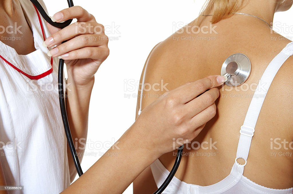 Female doctor with stethoscope examining patient royalty-free stock photo
