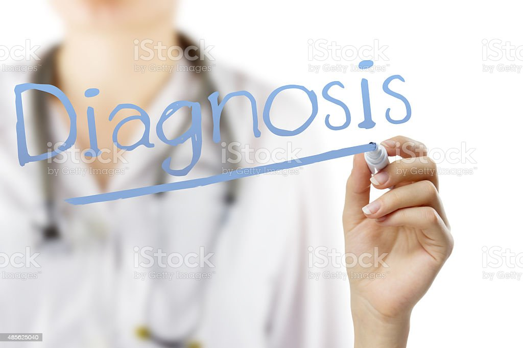 Female doctor with stethoscope writing 'Diagnosis' stock photo