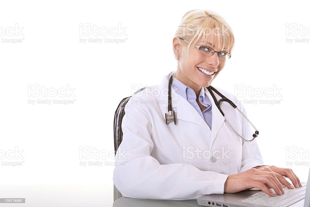 Female doctor working at her desk stock photo