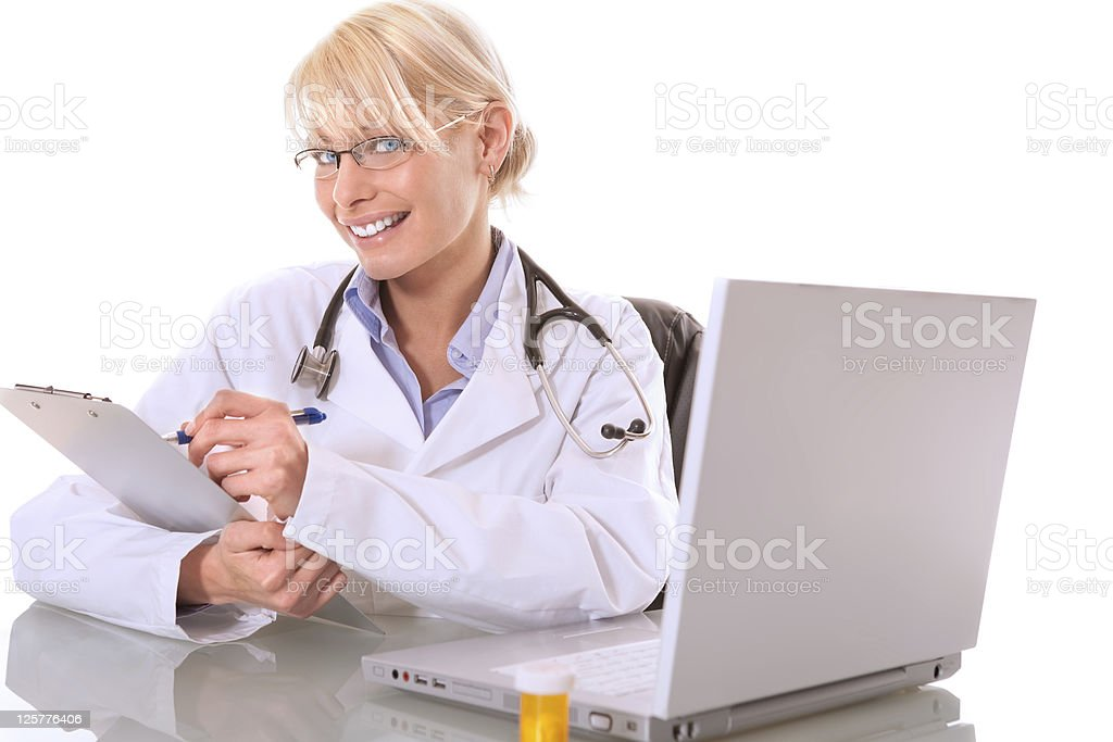 Female doctor working at her desk royalty-free stock photo