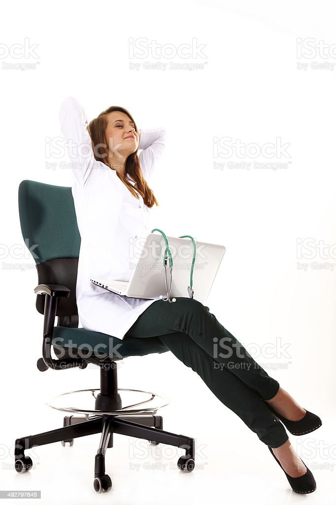 Female doctor working on her laptop isolated stock photo
